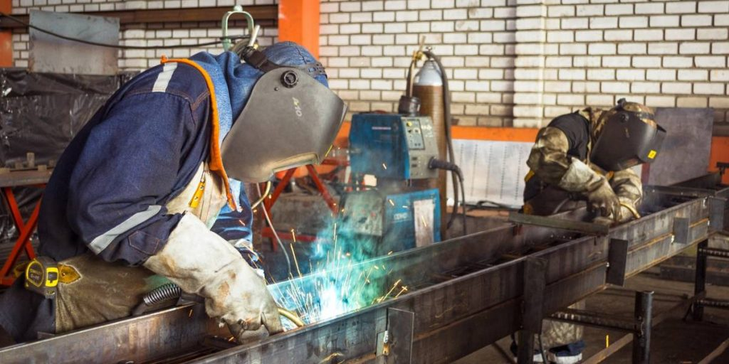 Working on welding metal
