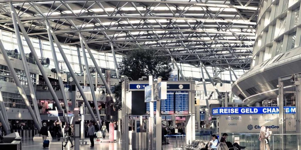 Crowded airport with steel structure elements